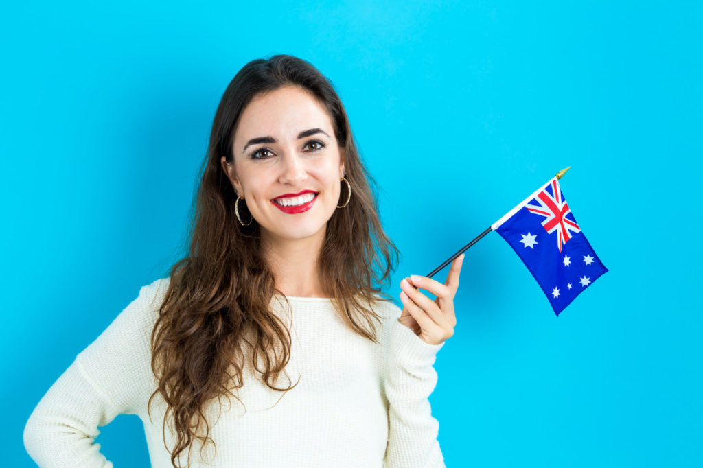 Young woman holding Australian flag